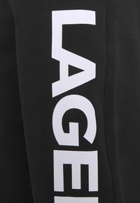 KARL LAGERFELD - PANTS - Tracksuit bottoms - black - 2