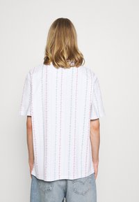 Karl Kani - UNISEX SIGNATURE LOGO TEE - Print T-shirt - white - 2