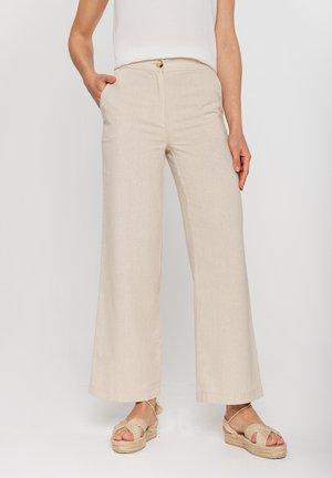 Spodnie materiałowe - beżowy