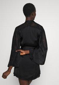 Hunkemöller - KIMONO  SLEEVE INSERT - Dressing gown - black - 3