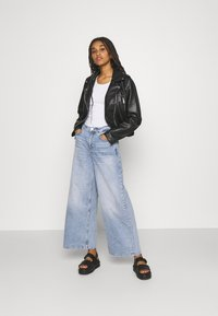 Tommy Jeans - ULTRA WIDE LEG - Relaxed fit jeans - light blue denim - 1