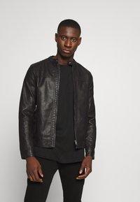 Jack & Jones - JORWARNER JACKET - Faux leather jacket - black - 0