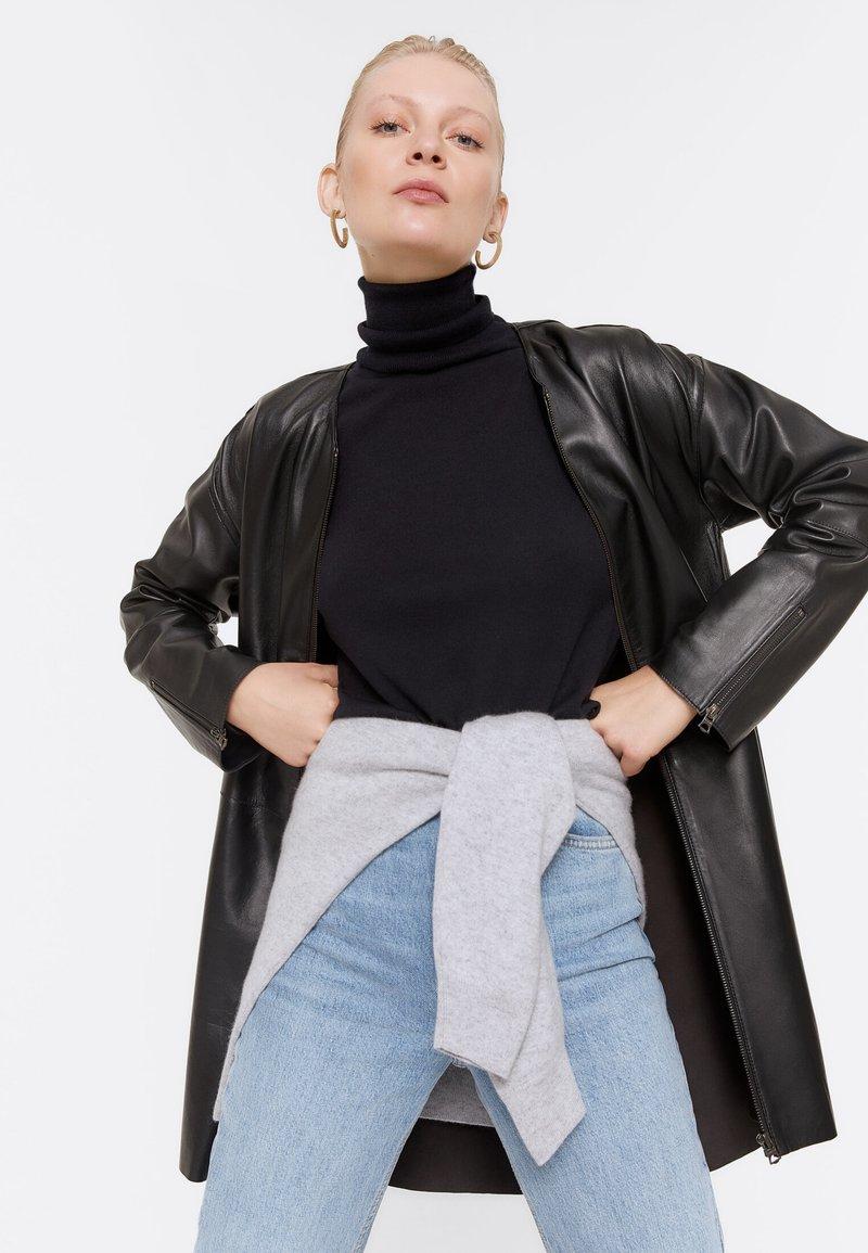 Uterqüe - Leather jacket - black