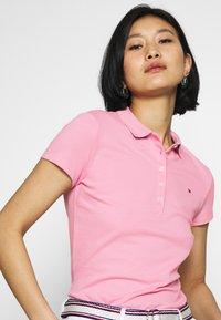 Tommy Hilfiger - NEW SHORT SLEEVE SLIM - Poloskjorter - matte pink - 4