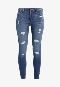 Hollister Co. - STRECH HIGH RISE SUPER SKINNY  - Jeans Skinny Fit - medium wash - 5