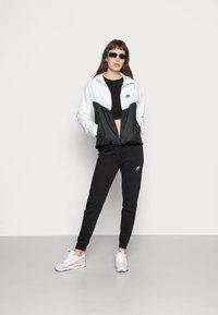 Nike Sportswear - Training jacket - white/black - 1