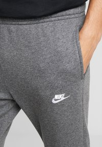 Nike Sportswear - CLUB - Tracksuit bottoms - charcoal heather/anthracite/white - 3