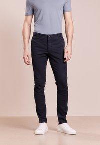Tiger of Sweden - TRANSIT - Trousers - light ink - 0