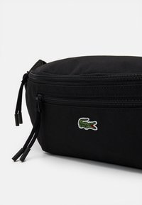 Lacoste - WAIST BAG UNISEX - Bum bag - black - 3