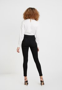 Vero Moda - VMJOY MIX - Jeans Skinny Fit - black - 2