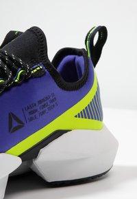 Reebok - SOLE FURY TS - Zapatillas de entrenamiento - purple/black/neon lime - 5