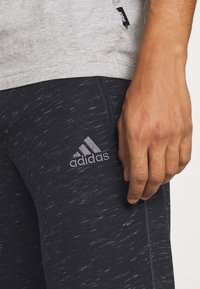 adidas Performance - Tracksuit bottoms - black melange - 3