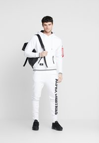 Alpha Industries - Tracksuit bottoms - white - 1