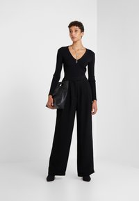 Lovechild - LULAS - Trousers - black - 1