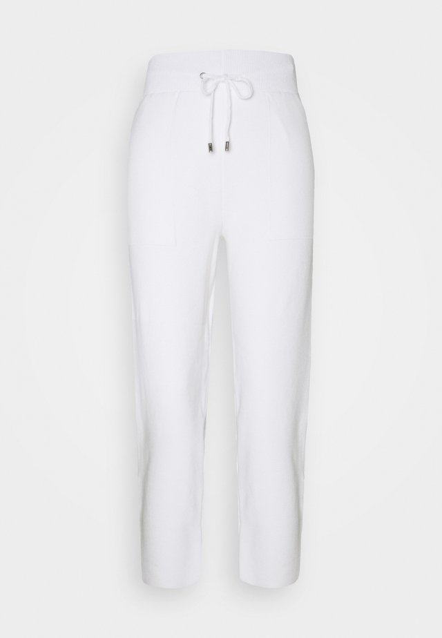 COORD OVOID - Tracksuit bottoms - ivory