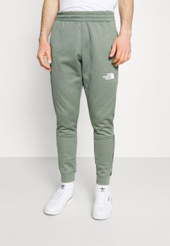 PANT - Teplákové kalhoty - agave green