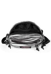 Eastpak - ADA - Across body bag - anml shinelines - 3
