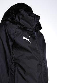 Puma - LIGA TRAINING RAIN JACKET CORE - Hardshell jacket - black/white - 3