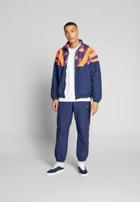 adidas Originals - GRAPHICS SPORT INSPIRED TRACK TOP - Training jacket - blue - 1