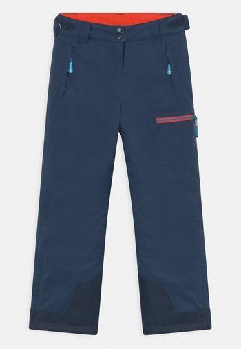 HALLINGDAL UNISEX - Snow pants - navy/flame orange