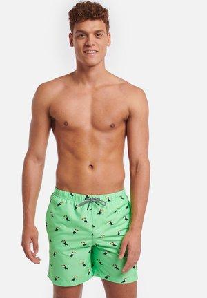 TUCAN - Swimming shorts - neon green