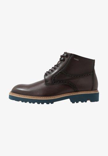 VILLOD - Lace-up ankle boots - havanna