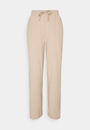 IHYOSE - Tracksuit bottoms - natural
