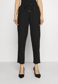 Marks & Spencer London - TAPERED - Trousers - black - 0
