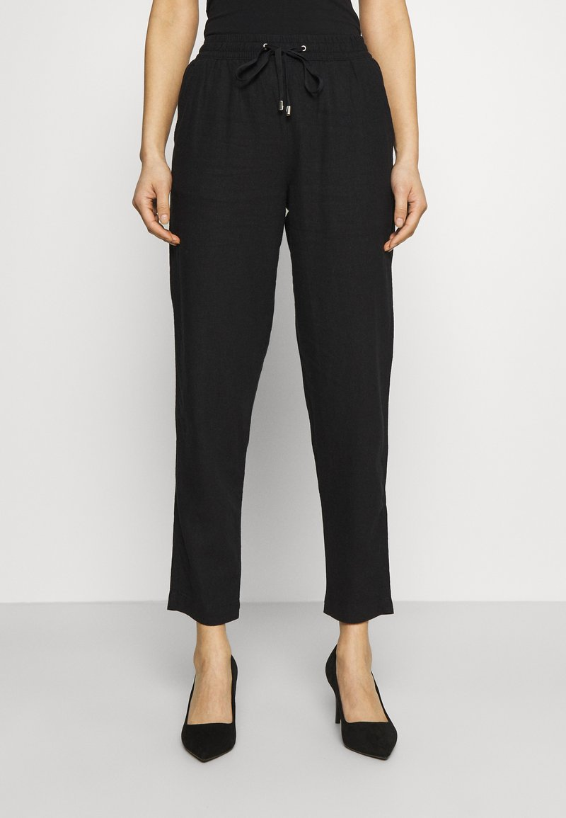 Marks & Spencer London - TAPERED - Trousers - black