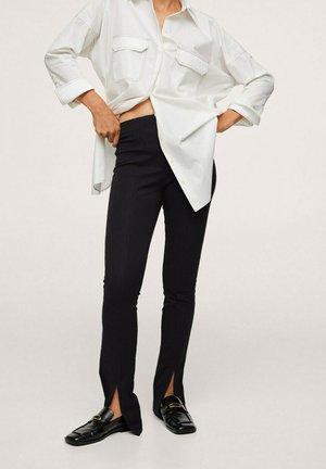 ABERTURA BAJO - Trousers - black