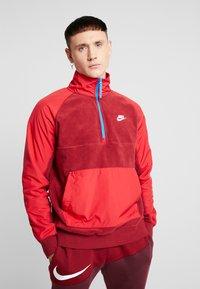 Nike Sportswear - WINTER - Fleece trui - team red/gym red/lt photo blue/white - 0