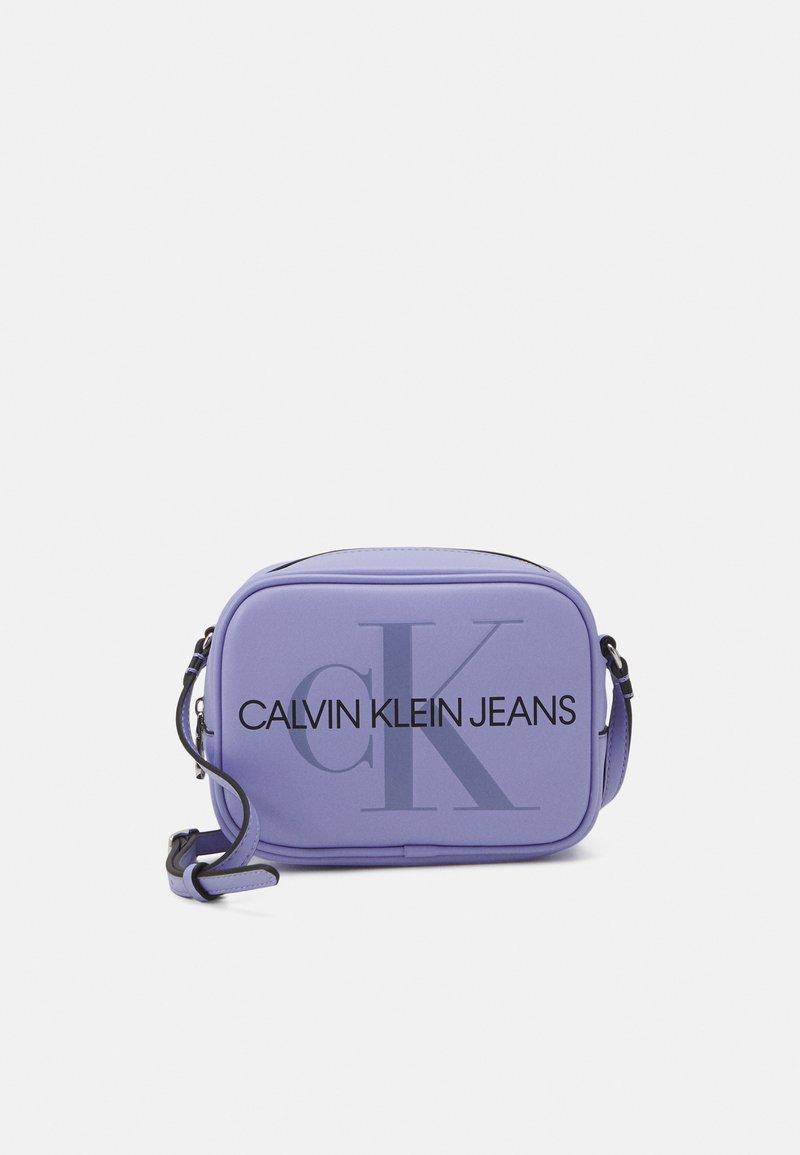 Calvin Klein Jeans - CAMERA BAG - Across body bag - lilac