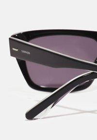 Calvin Klein - UNISEX - Sunglasses - black - 3