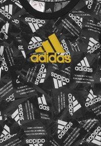 adidas Performance - UNISEX - Printtipaita - black/yellow/white - 2