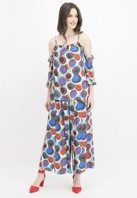 Nicowa - MIT GESCHLITZEM BEIN - Trousers - blue - 1