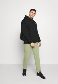 Diesel - PETER TROUSERS - Tracksuit bottoms - olive - 1