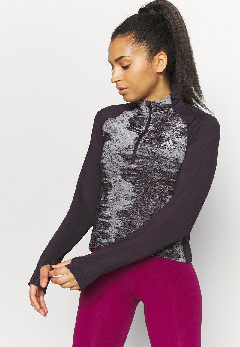 adidas Performance - ZIP - Sports shirt - purple