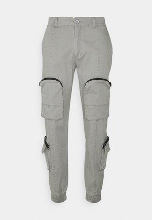 REVOLUTION - Pantalon cargo - acid grey