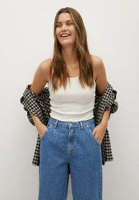 Mango - REGINA - Relaxed fit jeans - middenblauw - 3