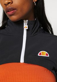 Ellesse - LAUDE CROP TRACK  - Summer jacket - black - 7