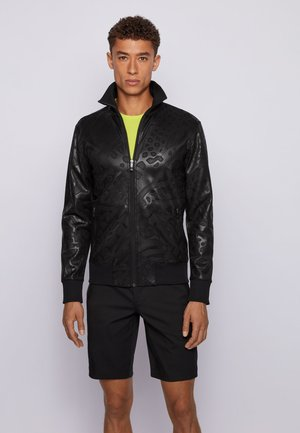 SKARLEY - Training jacket - black