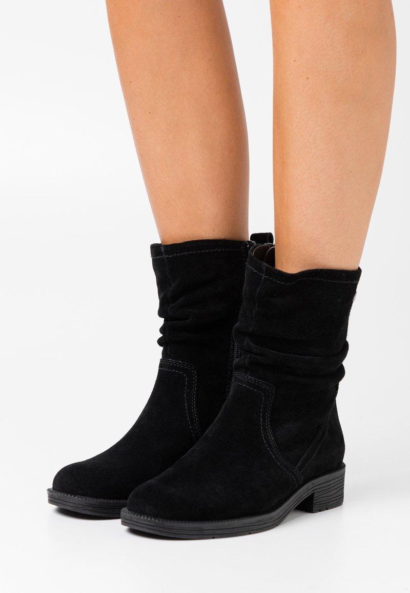Jana - Classic ankle boots - black