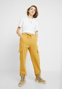 Monki - WILLOW - Tracksuit bottoms - camel - 1