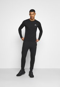 Alpha Industries - BASIC JOGGER FOIL - Tracksuit bottoms - black/yellow gold - 1