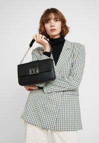 ALDO - HAEDITH - Håndtasker - black - 1