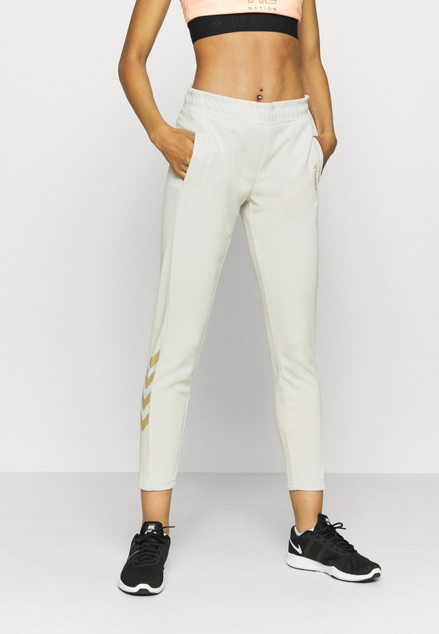 HMLZIBA TAPERED PANTS - Verryttelyhousut - bone white