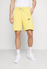 Nike Sportswear - REVIVAL - Short - solar flare/smoke grey - 0