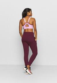 Nike Performance - FLOW HYPER 7/8 PANT - Tracksuit bottoms - night maroon - 2