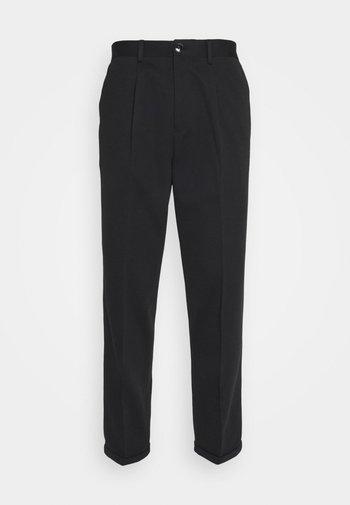 SLHSLIMTAPERED JIM FLEX ANKLE - Trousers - black
