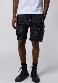 Tigha - Shorts - black - 0